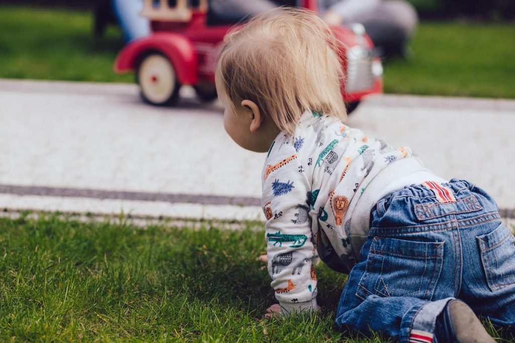 Toddler playing outside